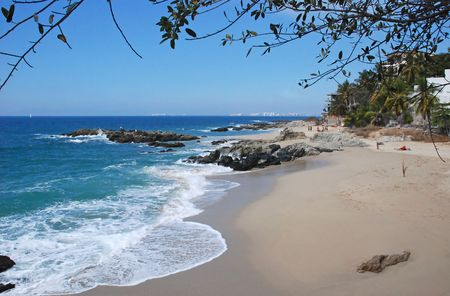 Tropical beach on the Pacific Ocean in Conchas Chinas, Puerto Vallarta, Mexico photo