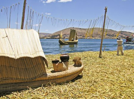 Floating reed island and boats on Lake Titicaca, Peru