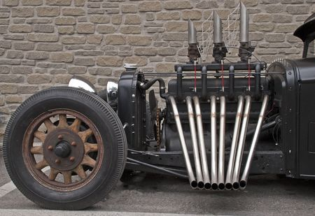 Truck based roadster with unmuffled exhaust pipes Reklamní fotografie - 7753644