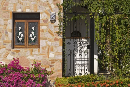 ornamentals: Tropical facade decorated with flowering ornamentals in Puerto Vallarta, Mexico Stock Photo