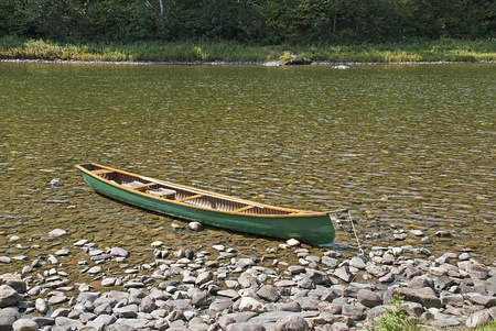 Canoe anchored on the Matapedia River, Quebec, Canada Stock Photo - 11309220
