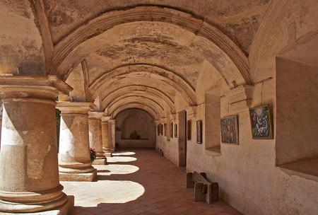 Spanish colonial arcade in the historic Capuchin Convent in Antigua, Guatemala
