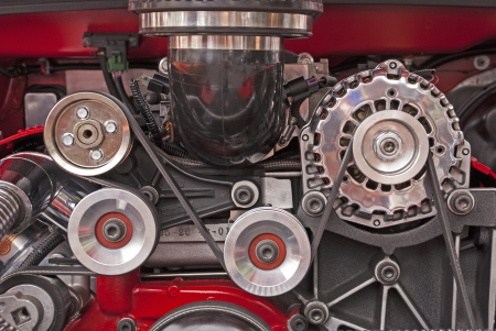 Engine drive pulleys in a high-performance V-8 engine