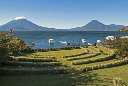 Lake Atitlan in Guatemala with volcanoes Toliman and San Pedro in background Stock Photo