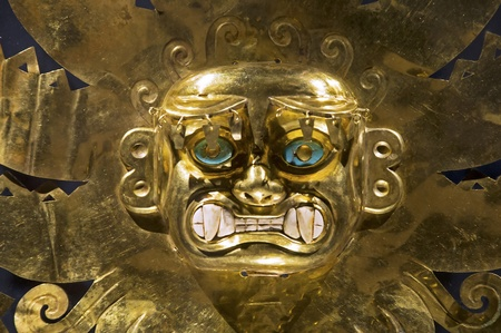 Gold head ornament from the ancient Mochican civilization in Peru
