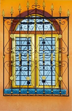 Spanish colonial style wrought iron window decor Banco de Imagens