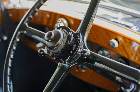 Steering wheel with ignition controls on an antique automobile