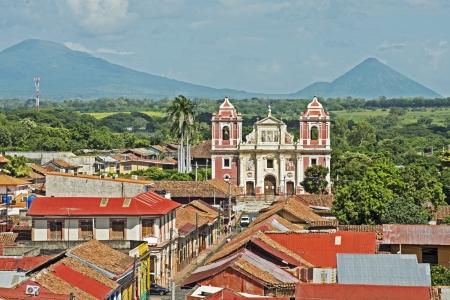 Facade of El Calvario Church with volcanoes in background,  Leon, Nicaragua