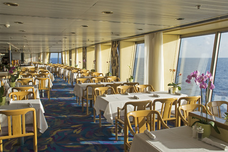 dinner cruise:  Dining area on a mid-sized cruiseship at sea