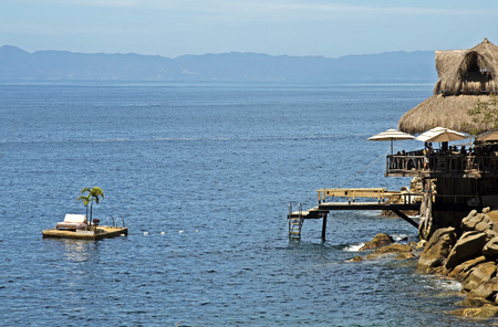palapa: Beach palapa  with floating deck on the Mexican Pacific Ocean, near Puerto Vallarta Stock Photo