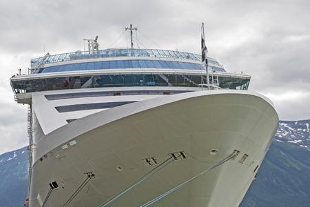 Cruiseship bow with mountain background, Skagway, Alaska photo