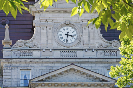 neoclassic: Clock on neo-classic city building in Montreal, Quebec, Canada
