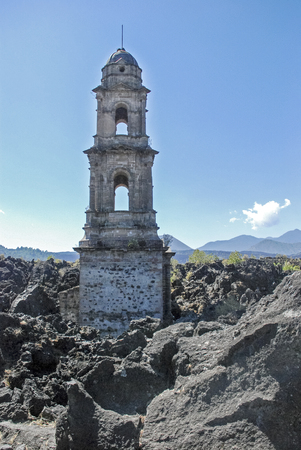 steeple: Steeple prodruding from lava of buried Mexican village San Juan Parangaricutiro in Uruapan. Stock Photo