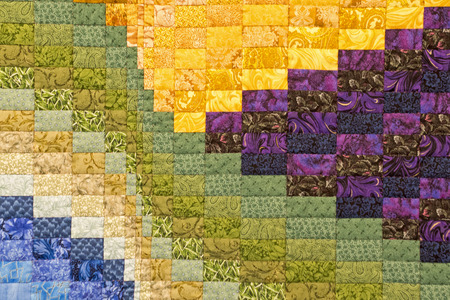 Detail of a colorful and geometrically patterned quilt