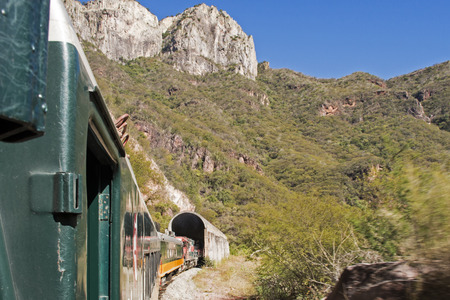 El Chepe train entering Copper Canyon mountain tunnel in Chihuahua, Mexico
