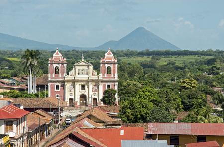 Church facade with volcano in Leon, Nicaragua Banco de Imagens