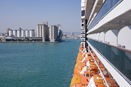 Storage tanks in harbour with cruiseship detail foreground