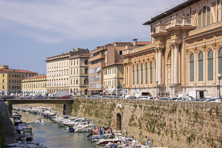 Old market buildings with canal, Livorno, Italy