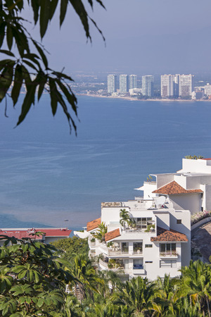 Tropical architecture in the hills of Puerto Vallarta with ocean background Stock Photo