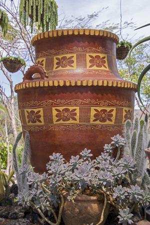 Mexican clay pot in a tropical garden Stock Photo