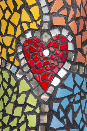 Heart shaped artwork from ceramic and glass fragments