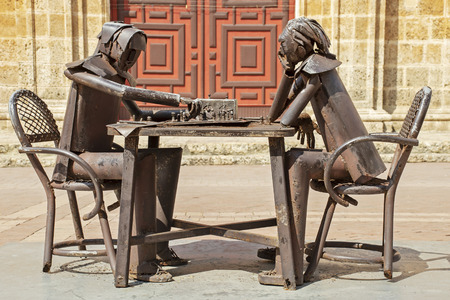 Welded metal figures playing chess in Cartagena, Colombia Stock Photo