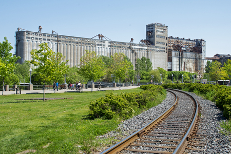 Railroad tracks leading to an old silo, Montreal, Quebec, Canada Stock Photo