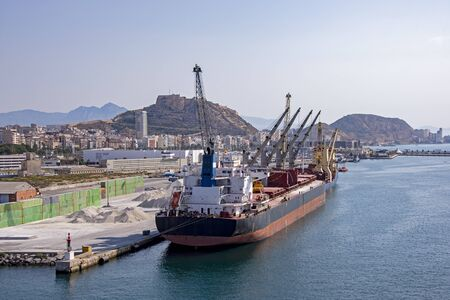Port of Alicante, Spain with freighter in foreground