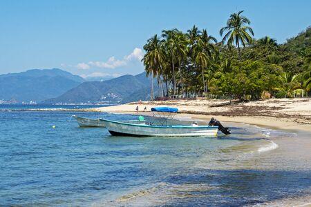 Tranquil beach with boats, Quimixto, Mexico Stock Photo