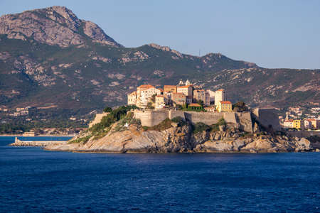 View from the sea of Calvi, Island of Corsica Editorial