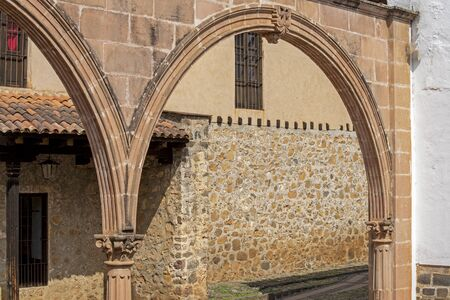 Restored Colonial Spanish arched wall in Patzcuaro, Mexico Stock Photo