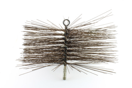 Side view of a steel bristle chimney sweep brush isolated on white