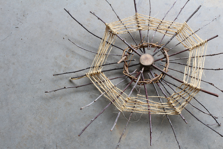 original ecological: Art sculpture using wood, sticks, vines, and twine, viewed from an oblique angle Stock Photo