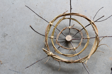 Concentric circles abstract sculpture from sticks and vines