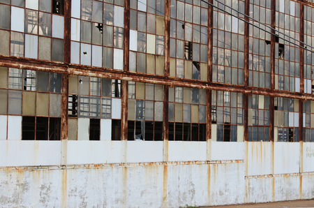 warehouse building: Broken windows on an abandoned factory Stock Photo