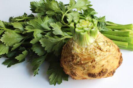 Freshly cut celery root and tops