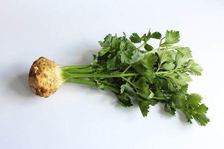 Full top view of celery root and stems