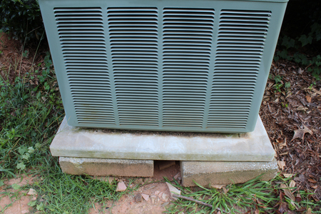 Detail of a heat pump on an unstable base