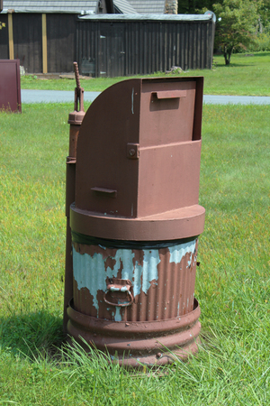 Metal trash can with bear proof lid 写真素材