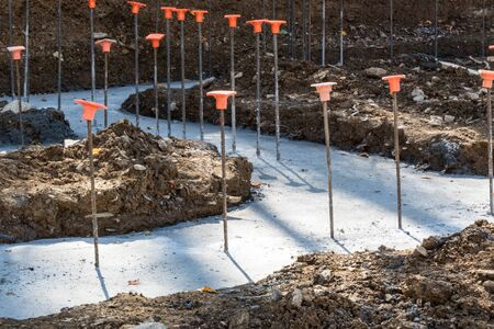 Construction site with rebar in poured footings for a building, horizontal aspect Stock Photo