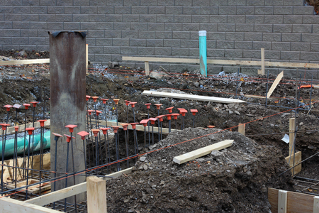 Construction site view with level lines pipes and rebar, horizontal aspect