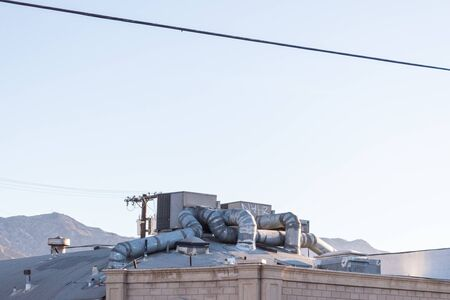 Elaborate heating and cooling system on the roof of a building with elaborate ductwork, copy space, horizontal aspect Stock Photo