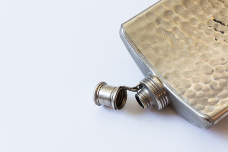 Open vintage metal flask isolated on white, drinking alcoholism addiction concept, copy space, horizontal aspect