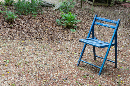 Empty blue folding chair outdoors, copy space, death grief absense concept, horizontal aspect Banco de Imagens