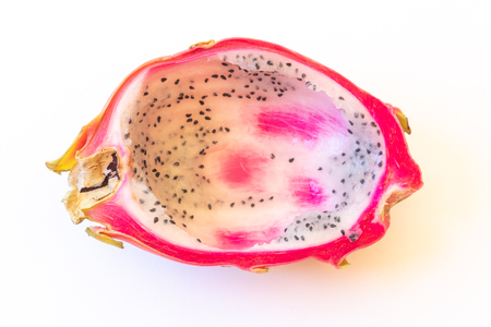 Close view of a white dragon fruit with pulp spooned out, isolated on white, horizontal aspect