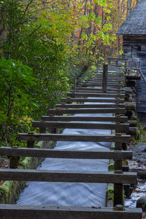 Wood sluice leading up to an old mill, Great Smoky Mountains, vertical aspect