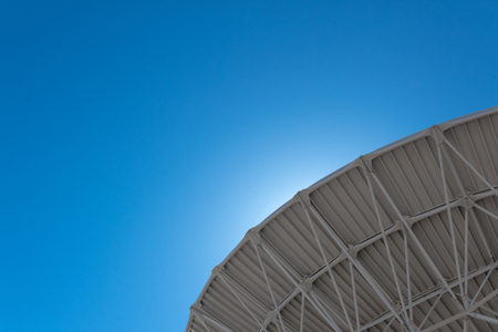 Very Large Array backlit curve of radio astronomy observatory dish in clear sky, science technology space exploration, horizontal aspect Stock fotó