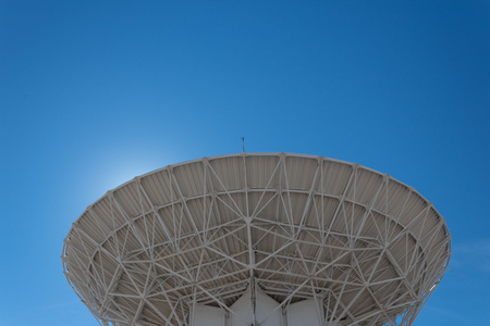 Very Large Array backlit radio astronomy observatory dish in clear sky, science technology space, horizontal aspect Stock fotó