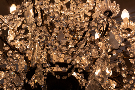 Close up view of an antique crystal chandelier, horizontal aspect