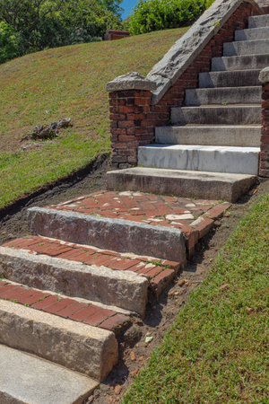 Stairs from mixed found materials, stone, marble, concrete, and brick, vertical aspect Stok Fotoğraf